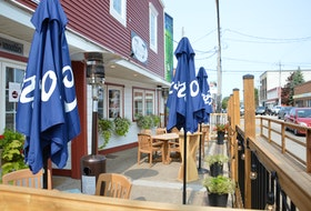 Outdoor patios, such the one that Seven by Seven Restaurant set up on Charlotte Street in Sydney last summer, attract people to the downtown core, according to the Sydney Downtown Development Association. GREG MCNEIL/CAPE BRETON POST