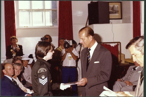 Prince Philip receives a gift from an air cadet during a Royal visit to Newfoundland and Labrador in 1978. PHOTO COURTESY OF THE ROOMS  (VA 70-14.2)