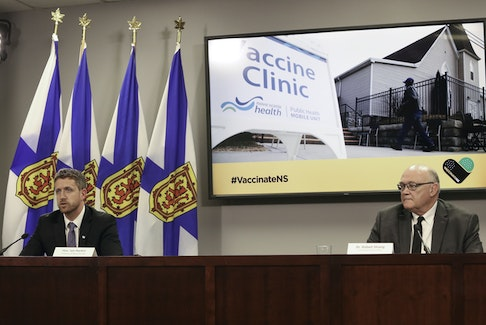 Nova Scotia Premier Iain Rankin and Dr. Robert Strang, chief medical officer of health, hold a COVID-19 briefing Friday, April 9, 2021, in Halifax.