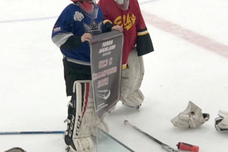It was a banner season for goalies Niall Dingwell, left, and Taylor Bowser who split their playing time between the Titans and Elks U13 teams.    - Contributed