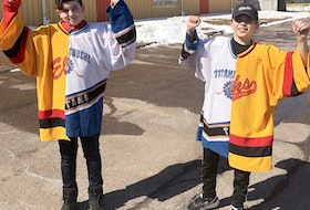 Niall Dingwell, left, and Taylor Bowser split goaltending duties between their hometown Tatamagouche Titans and the Brookfield Elks this season. The netminders were presented with half-and-half jerseys that were cut and stitched back together to include both team's colours.