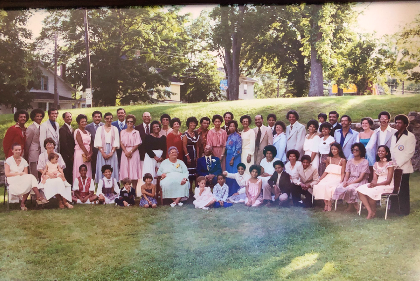 """The family reunion photo was taken near Truro's former Keddy's Motor Inn. Naomi and Bill Maxwell are seated in the front row. Over Naomi's right shoulder, wearing a black top is Cleo Maxwell (Stan's wife). To the right are Shirley Johnson and Ruth Mentis. In the back row, sixth from left, is Warren Maxwell. To the right are Stan """"Chook"""" Maxwell and Marg Jackson."""
