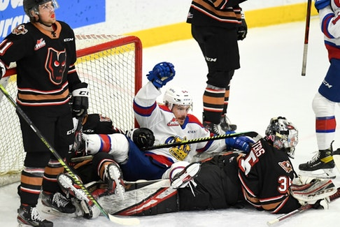 The Edmonton Oil Kings and Calgary Hitmen have a pileup in the crease during  game at Seven Chiefs Sportsplex in Calgary on March 27, 2021.