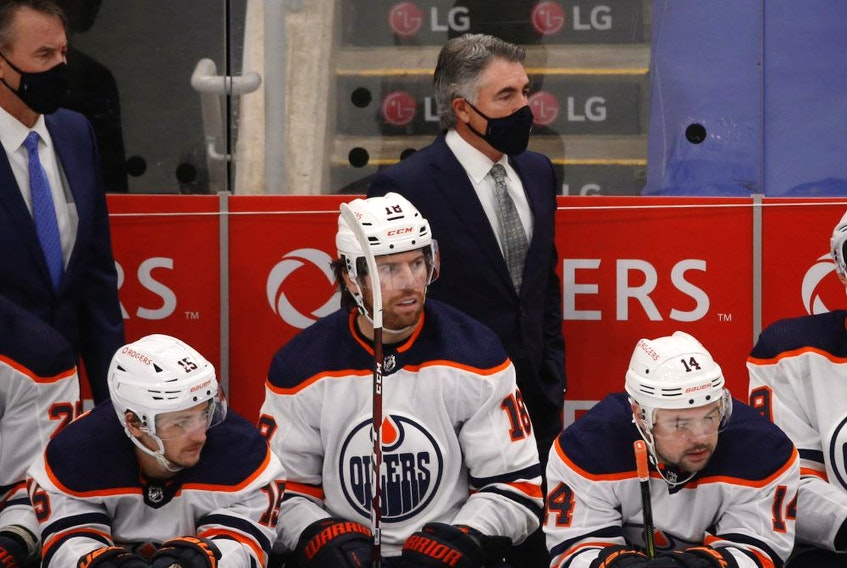 Edmonton Oilers coach Dave Tippett behind the bench during the first period in Toronto on Friday January 22, 2021.