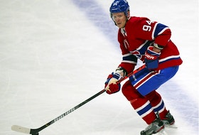 Montreal Canadiens' Corey Perry moves the puck up the ice during the first period against the Calgary Flames in Montreal on April 14, 2021.