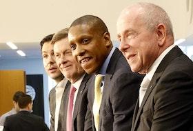 Toronto Raptors president Masai Ujiri (second from right) and MLSE CEO Larry Tanenbaum (right).