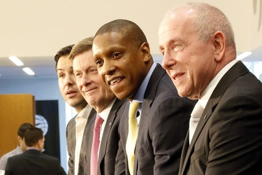 Toronto Raptors president Masai Ujiri (second from right) and MLSE CEO Larry Tanenbaum (right).