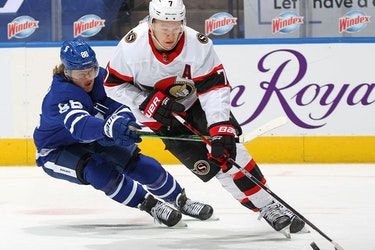 Brady Tkachuk  of the Ottawa Senators controls the puck against William Nylander of the Toronto Maple Leafs during an NHL game at Scotiabank Arena on February 15, 2021 in Toronto, Ontario, Canada. The Senators defeated the Maple Leafs 6-5 in overtime.