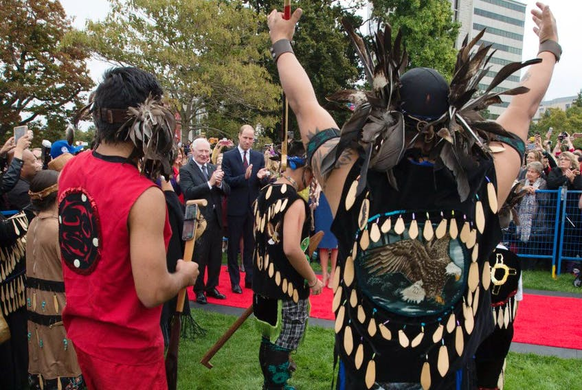 Prince William the Duke of Cambridge and Canada's Governor General David Johnston (3L) watch First Nations traditional dancers in front of the Legislative Assembly in Victoria, British Columbia on September 24, 2016.