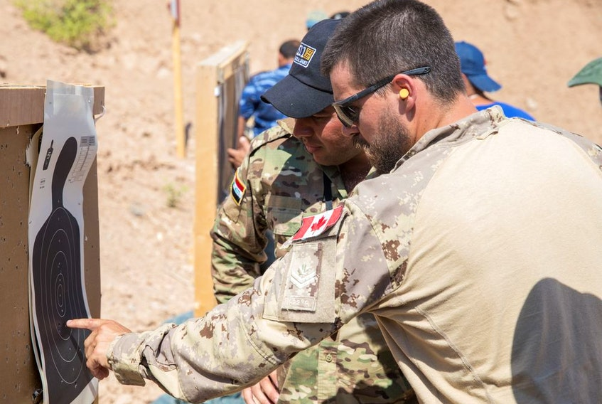 This 2019 file photo shows a Canadian Forces member at a U.S. base near Mosul teaching combat skills to Iraqi Wide Area Security Forces.