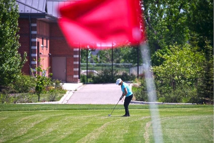 A golfer plays on the Richmond Green golf course.