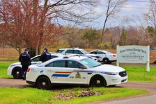 RCMP vehicles fill five driveway of the Weston Christian Fellowship Church near Berwick Sunday morning. Police ticketed 26 people and the church for illegally gathering contrary to public health orders. -Adrian Johnstone