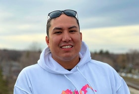 Mike Scott wears a hoodie from his Okimâw clothing line, one of two the Sturgeon Lake First Nation man owns. Okimâw is the Cree word for leader, boss, chief and it is used to promote positive leadership.