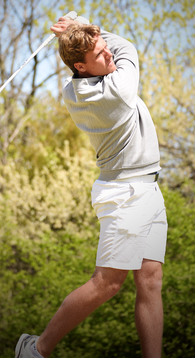 Matthew Chandler tees off for the Winona State University men's golf team earlier this season. - Xenia Straight