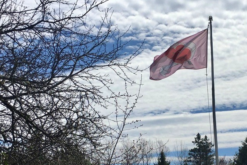 """Don Burch of Chester Basin sent this inspirational photo of a Heart Flag he raised during the latest COVID-19 shutdown. In many places, like Victoria, B.C., the Heart Flag is considered a symbol of solidarity, gratitude and hope. Don said he knows how much Cindy likes clouds. He said he will fly this flag """"until I can visit my children and grandkids again."""" Thank you for sharing this photo, Don."""