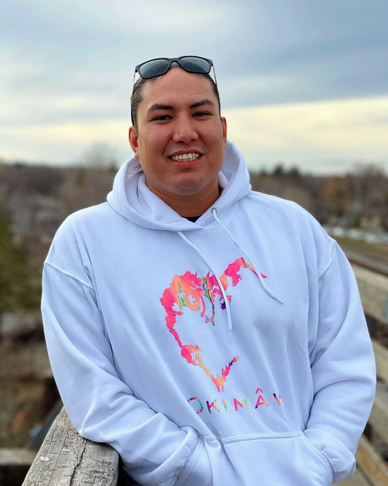 Mike Scott wears a hoodie from his Okimâw clothing line, one of two the Sturgeon Lake First Nation man owns. Okimâw is the Cree word for leader, boss, chief and it is used to promote positive leadership. CONTRIBUTED
