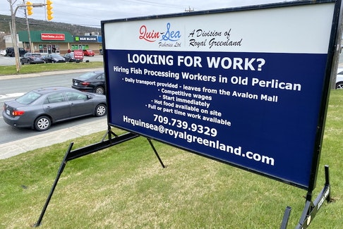 A billboard at the corner of Freshwater Road and Crosbie Road in St. John's advertizes jobs available at the QuinSea fish plant in Old Perlican.