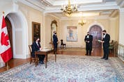In this March 31 photo, Richard Wagner, the Administrator of the Government of Canada, attends a socially distanced signing ceremony at Rideau Hall for two new bills.