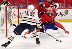 Montreal Canadiens goalie Carey Price stops Edmonton Oilers forward Josh Archibald during the second period at the Bell Centre in Montreal on on April 5, 2021.