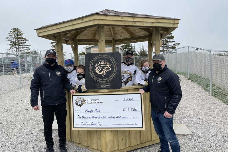 Coaches and players helped build a new backyard gazebo at the shelter.  - Contributed