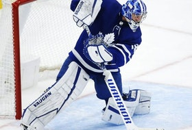 Toronto Maple Leafs Jack Campbell makes a save and fires the puck up the ice during second period action in Toronto on May 6, 2021.