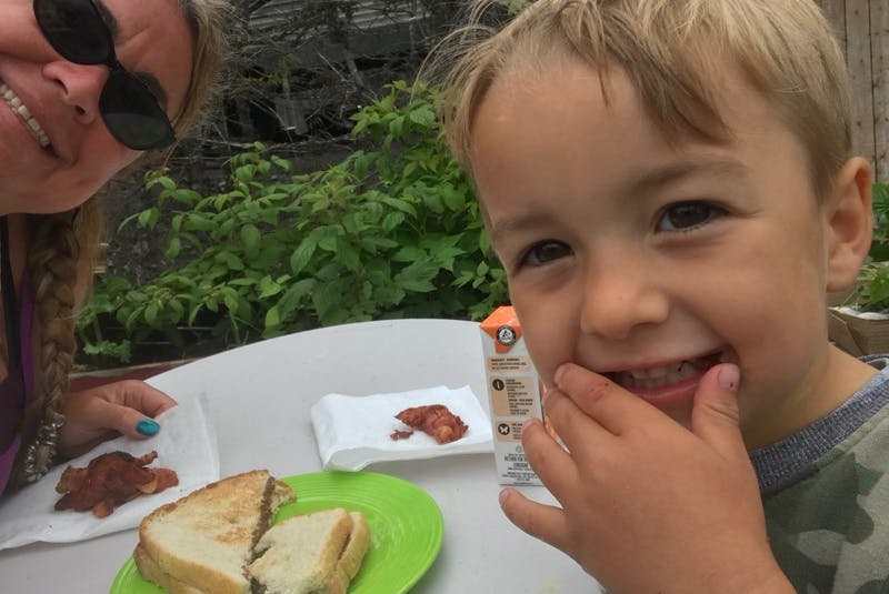 Pam Pardy and her four-year-old nephew, Kaleb Robinson, enjoy making treats together while camping. One of Kaleb's favourites is s'mores made in a foil pan. - Contributed