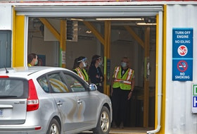 A patient drives their vehicle, into the drive-thru vaccination site near Dartmouth General Hospital Monday May 10, 2021.  The site opened today for patients.