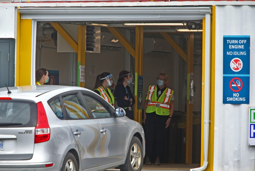 A patient drives their vehicle, into the drive-thru vaccination site near Dartmouth General Hospital Monday May 10, 2021.  The site opened today for patients.  TIM KROCHAK PHOTO