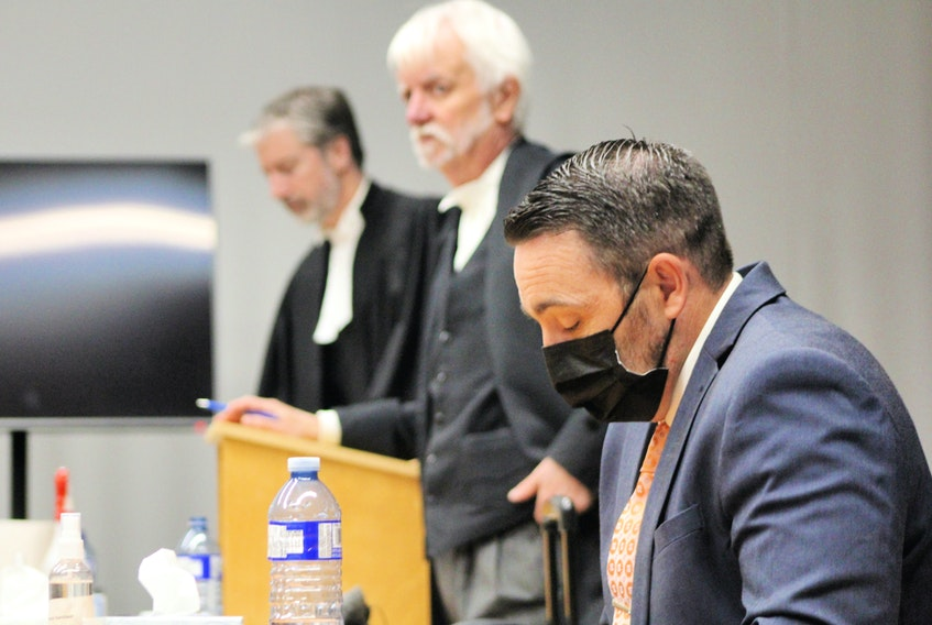 RNC officer Doug Snelgrove (front) sits in the dock at Newfoundland and Labrador Supreme Court at the former school for the deaf in St. John's after testifying Monday at his third trieal for sexual assault. Behind him are his defence lawyers, Randy Piercey (centre) and Jon Noonan. Tara Bradbury • The Telegram