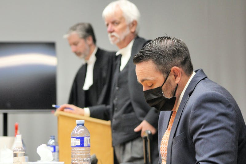 RNC officer Doug Snelgrove (front) sits in the dock at Newfoundland and Labrador Supreme Court at the former school for the deaf in St. John's after testifying Monday at his third trieal for sexual assault. Behind him are his defence lawyers, Randy Piercey (centre) and Jon Noonan. - Tara Bradbury/The Telegram