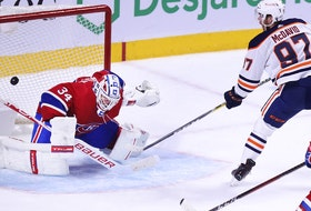Edmonton Oilers Connor McDavid scores the game-winning goal on Montreal Canadiens goalie Jake Allen as Jeff Petry trails the play during overtime of National Hockey League game in Montreal Monday May 10, 2021.