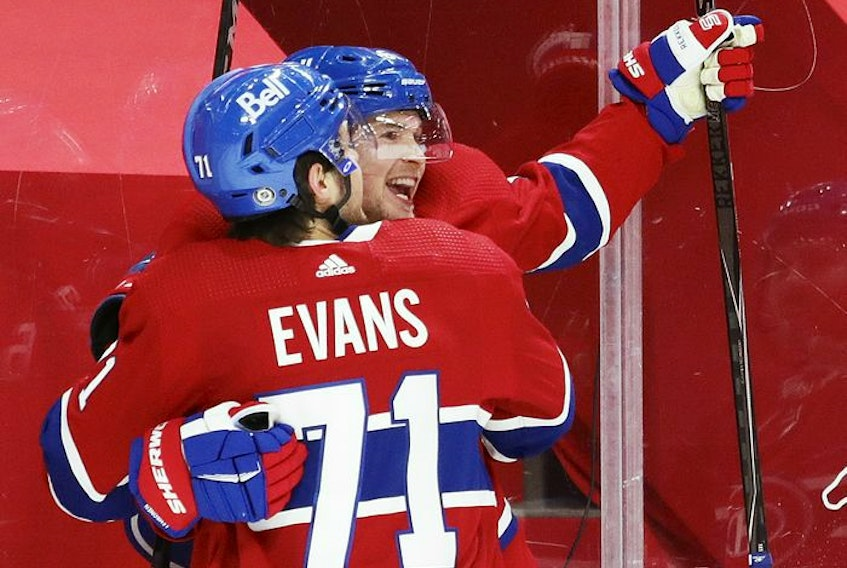 Artturi Lehkonen is congratulated by team-mate Jake Evans after scoring a goal to tie the game during third-period action in Montreal on Monday, May 10, 2021.