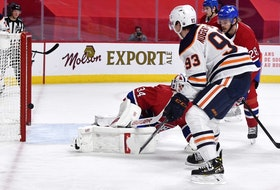Edmonton Oilers forward Ryan Nugent-Hopkins (93) scores a goal against Montreal Canadiens goalie Jake Allen (34) during the first period at the Bell Centre.