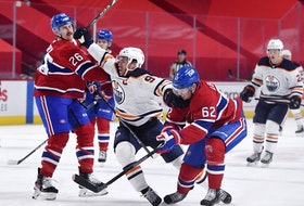 Edmonton Oilers forward Connor McDavid (97) attempts to go between Montreal Canadiens defenseman Jeff Petry (26) and teammate forward Artturi Lehkonen (62) during the first period at the Bell Centre.
