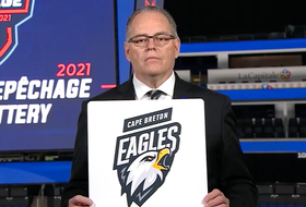 Pierre Leduc, QMJHL director of hockey operations, unveils the Cape Breton Eagles as the second overall pick for the 2021 QMJHL Entry Draft during the league's annual draft lottery on Tuesday. PHOTO/QMJHL