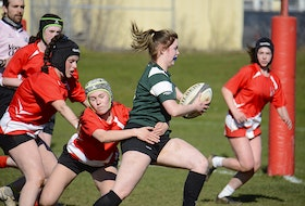 Abby MacPherson of the Charlottetown Rural Raiders tackles KISHORA's Emma Muttart Monday during Prince Edward Island School Athletic Association senior AAA girls rugby action in Charlottetown.