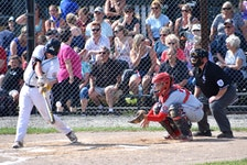 Blair Clowes of the Confederation Park Trappers of Alberta, left, fouls off a pitch as catcher Bryden Gardiner of the Cape Breton Ramblers and umpire George Long watch during Canadian Senior Little League Championship action at the Nicole Meaney Memorial Ball Park in Sydney Mines in July 2019. Little League Canada announced the cancellation of the 2021 tournament in Sydney Mines due to the COVID-19 pandemic. JEREMY FRASER • CAPE BRETON POST