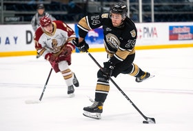 Charlottetown Islanders winger Drew Elliott prepares to take a shot in Game 2 of the Maritimes Division final with the Acadie-Bathurst Titan Sunday in Shawinigan, Que.