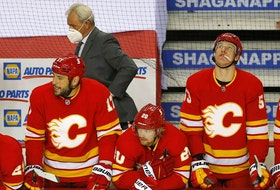 Calgary Flames players react as they lose 2-1 to the Montreal Canadiens in NHL action at the Scotiabank Saddledome in Calgary on Monday, April 26, 2021. On Monday night, they watched helplessly as the Canadiens eliminated them from playoff contention. Darren Makowichuk/Postmedia