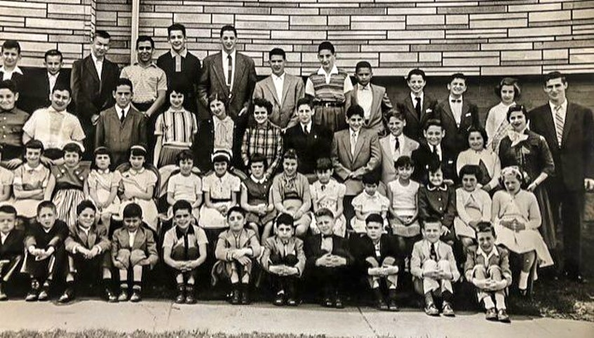 Sanford Cohen, standing, top row, far right, with a group of youth outside the Temple Sons Of Israel Synagogue in Sydney, c. 1957. CONTRIBUTED