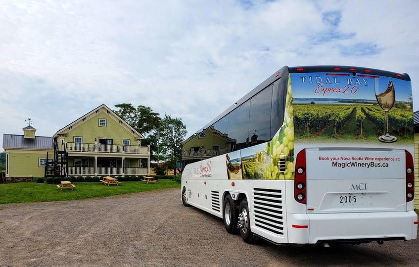 The Magic Winery Bus Ltd.'s Tidal Bay Express visiting Mercator Vineyards in 2020. - Contributed