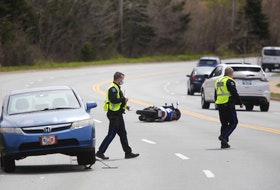 Halifax police work at the scene of a crash on Pleasant Street in Dartmouth that sent a motorcyclist to hospital with life-threatening injuries Tuesday, May 11, 2021.