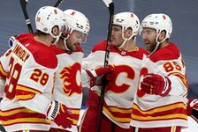 Calgary Flames celebrate their second goal against the Edmonton Oilers during second period NHL action at Rogers Place in Edmonton on Thursday, April 29, 2021.