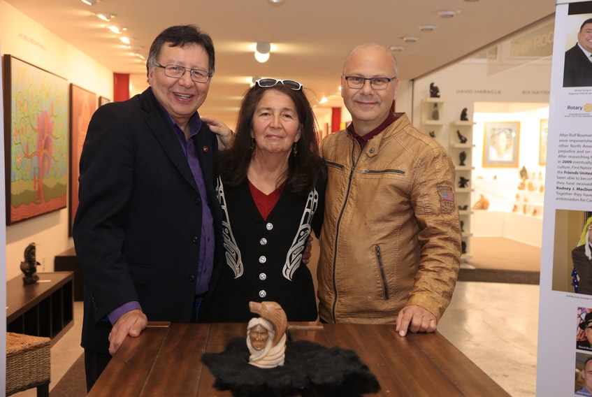 Senator Dan Christmas and his late wife, Dozay Christmas, with Rolf Bouman of Friends United in 2019 at the gallery's opening of her art exhibit. CONTRIBUTED