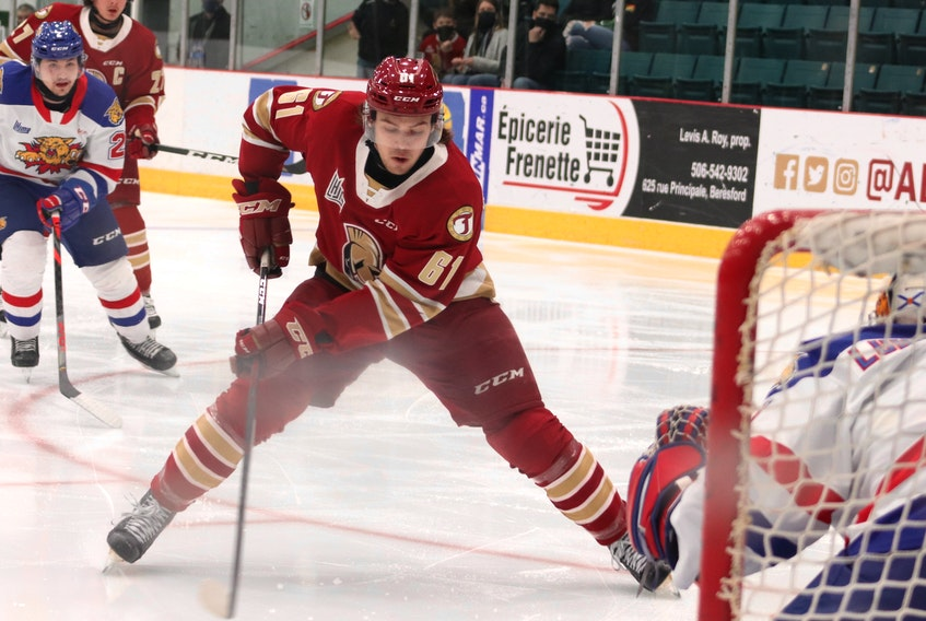 Acadie-Bathurst Titan forward Bennett MacArthur goes to the backhand to try to beat Moncton Wildcats goalie Dakota Lund-Cornish during Quebec Major Junior Hockey League action.
