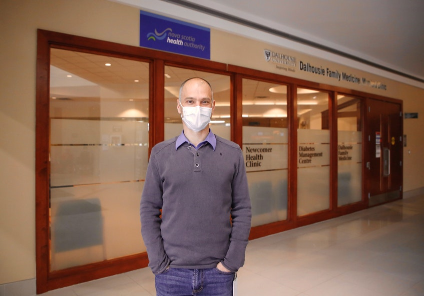Dr. Tim Holland said people should monitor their breathing and body temperature, but should also take advantage of the resources available in Nova Scotia to help them navigate their symptoms. He is seen outside the Dalhousie Family Clinic in Halifax on Tuesday, May 11, 2021. - Tim  Krochak