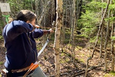 Jennifer Clarke aims at a target during a recent Down by the Bay Traditional Archery Club practice near Parrsboro.
