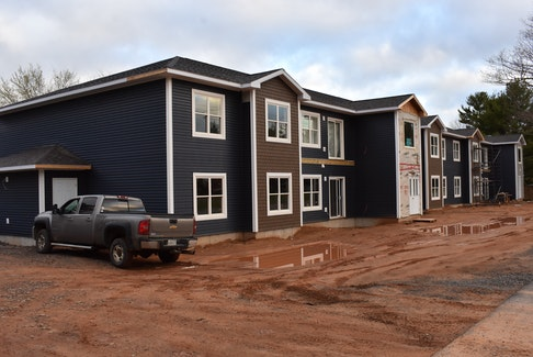 Scott Bishop of Embrook Investments Inc. is aiming to have this 12-unit apartment building along Bridge Street in Greenwood ready for tenants as of July 1. – Ashley Thompson