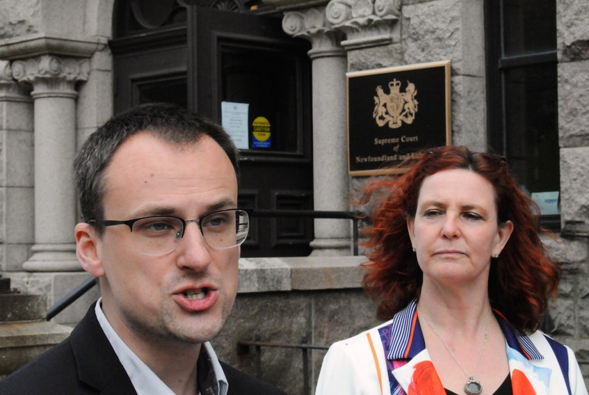 Kyle Rees, provincial NDP president and lawyer for NDP Leader Alison Coffin (right), speaks with reporters outside Newfoundland and Labrador Supreme Court in St. John's after Justice Donald Burrage's decision on Wednesday afternoon. Joe Gibbons • The Telegram
