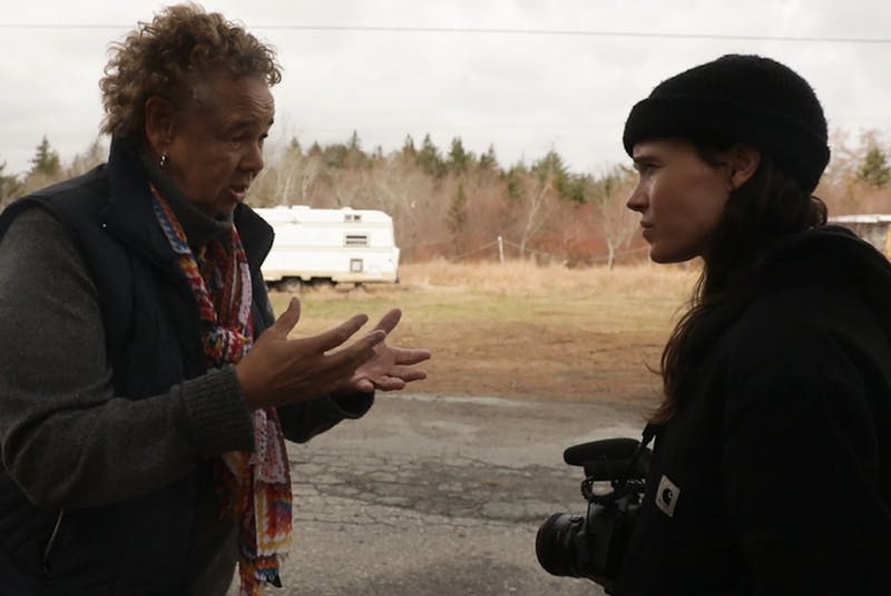 Shelburne based South End Environmental Injustice Society (SEED) founder and president Louise Delisle (left) talks with director Elliott Page in a photo promoting the release of the documentary, There's Something in the Water. - Contributed